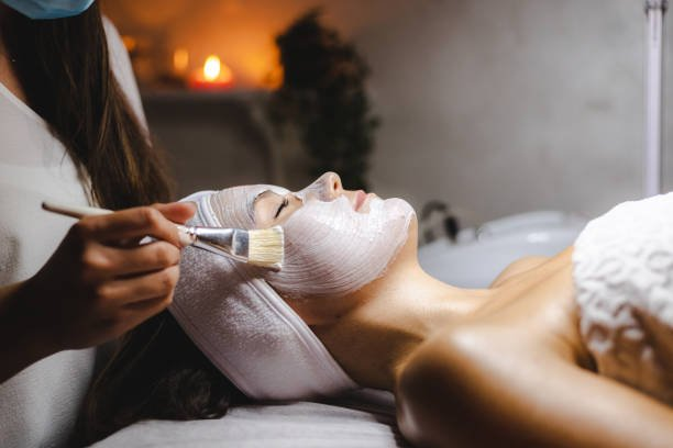 Shot of a young woman getting a facial treatment at a spa