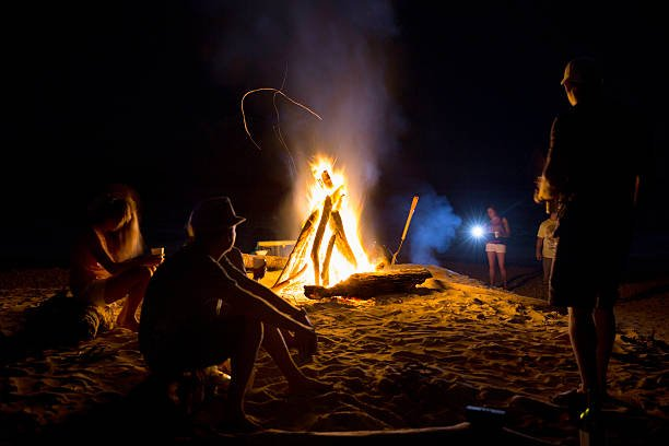 Real people having a Bonfire on the beach in Costa Rica