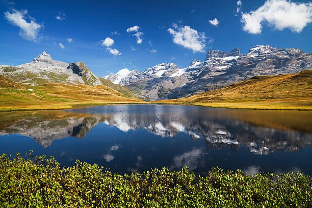 Idyllic mountain lake with Graustock and Titlis at the Melchsee-Frutt, Canton Obwalden, Switzerland.