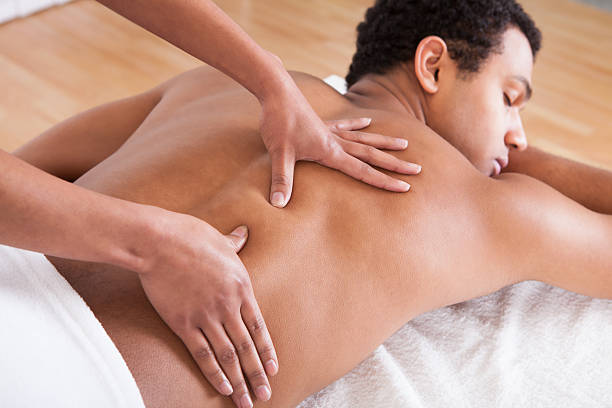 Portrait Of Man Receiving Massage Treatment From Female Hand