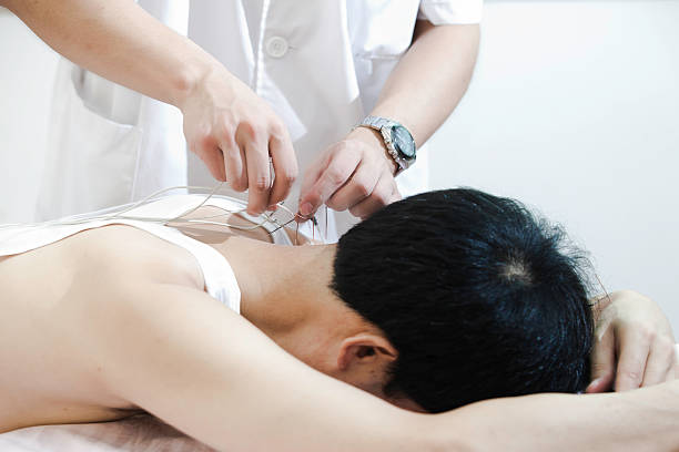 doctor are treating patients for acupuncture and electrotherapy