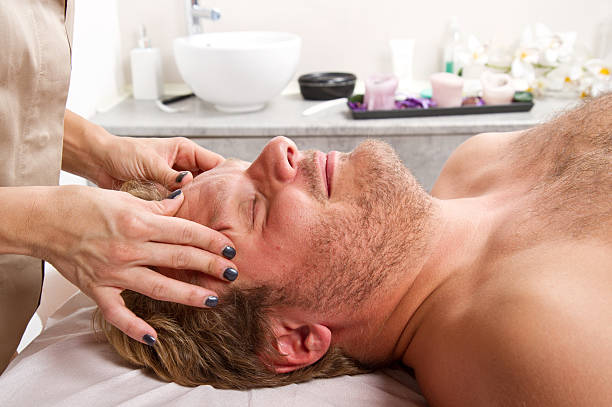a Man getting massage in thebeauty center