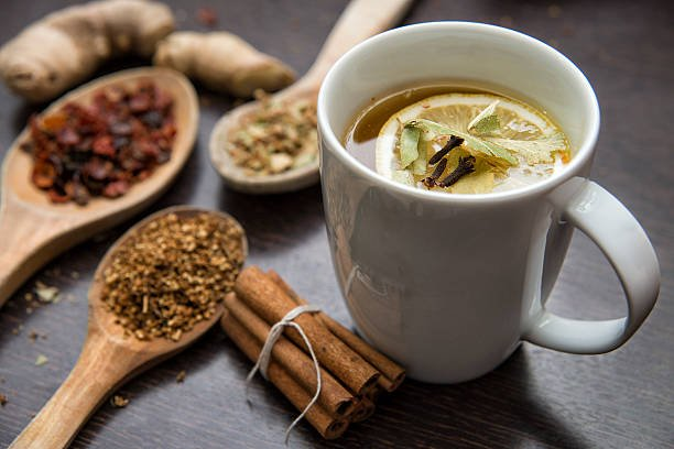 Dried Herbs With Cup Of Herbal Tea.