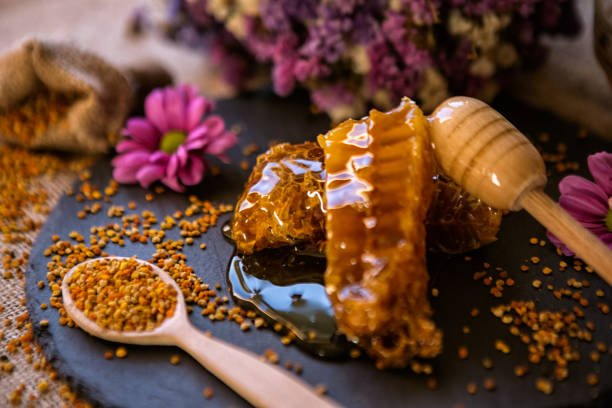 natural sweet honeycombs and pollen on table background
