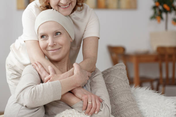 Family member supporting sick woman during chemotherapy
