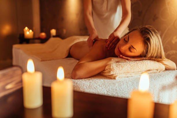 Young woman enjoying a massage at a spa