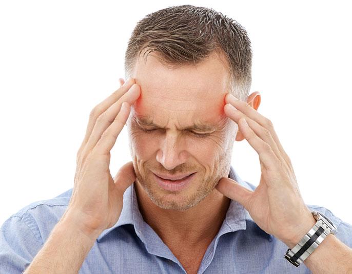 An elder person feeling pain his head